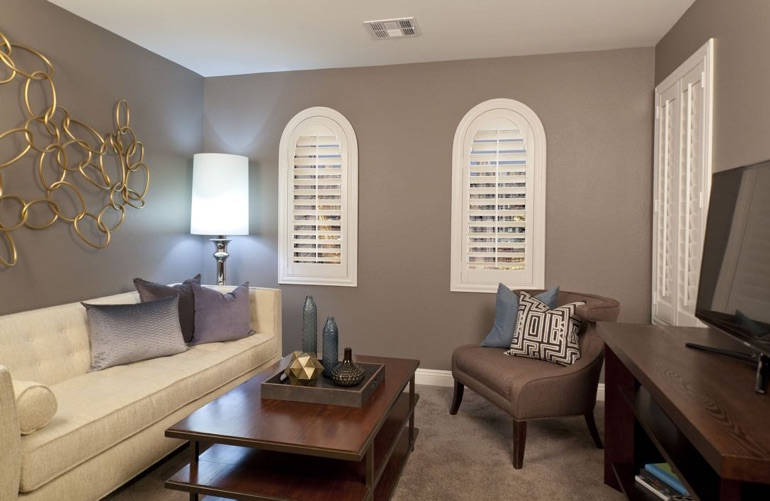 Minneapolis family room with rounded plantation shutters.