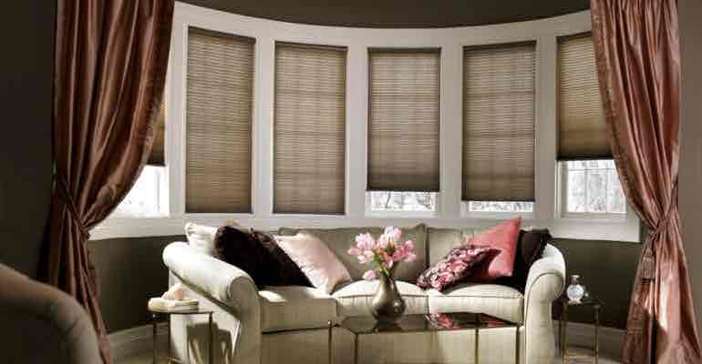 Vertical cellular shades in parlour bow window.