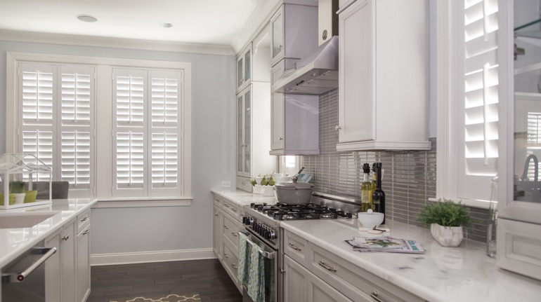 Polywood shutters in Minneapolis kitchen with modern appliances.