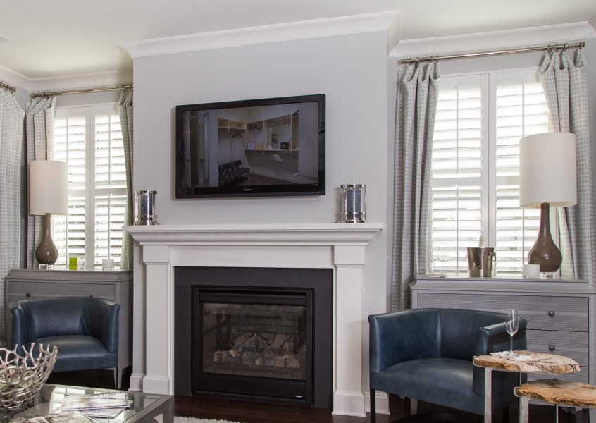tv room Minneapolis faux wood shutters
