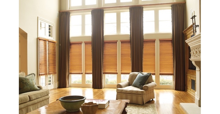 Minneapolis great room with natural wood blinds and full-length draperies.