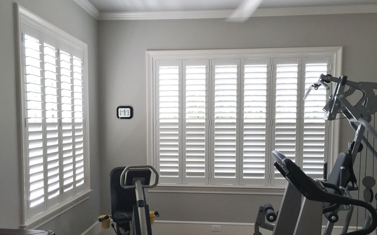 Minneapolis home gym with shuttered windows.