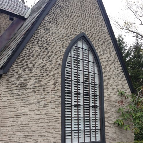 outdoor facade of brick home with plantation shutters