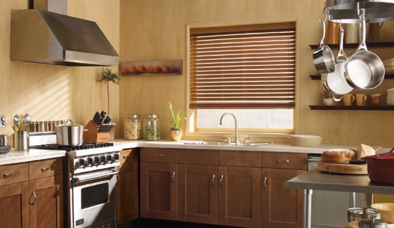 Minneapolis kitchen faux wood blinds.