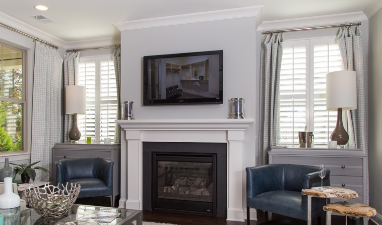Minneapolis fireplace with white shutters.