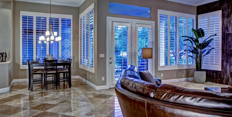 Minneapolis great room with classic shutters and tile floor.