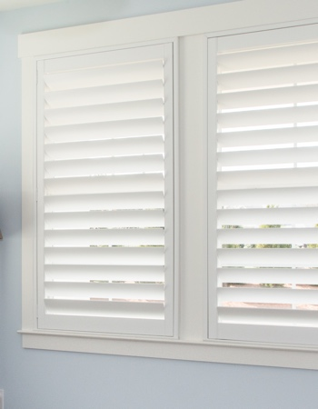 White plantation shutters with hidden tilt rods in Minneapolis