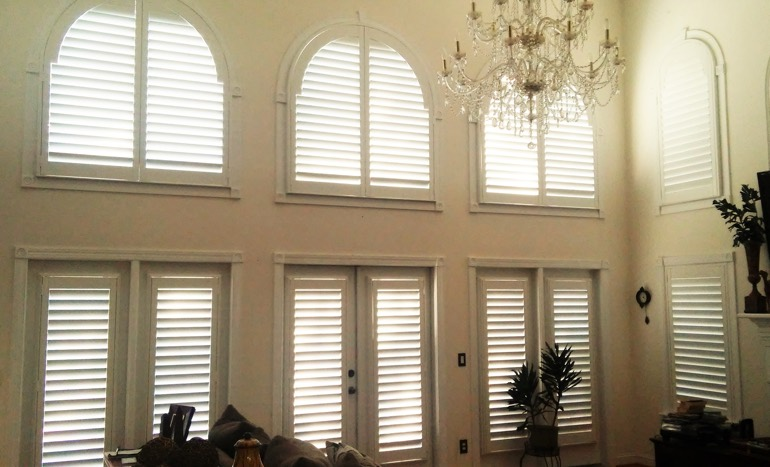 Television Room In Open Concept Minneapolis Home With Plantation Shutters  On Arch Windows.