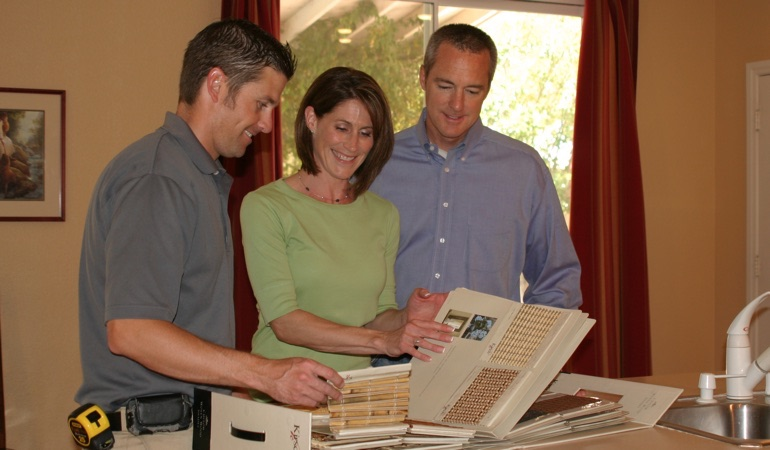People looking at samples of window treatments.