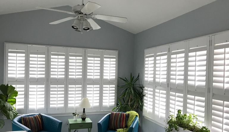 Minneapolis sunroom with fan and shutters