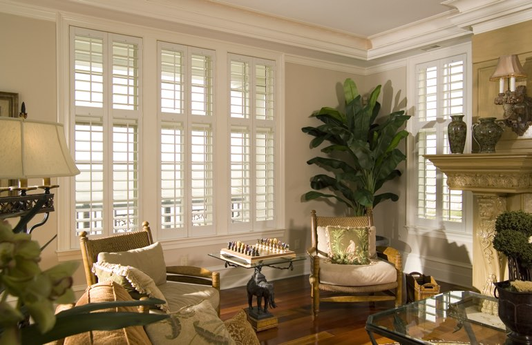 Living Room in Minneapolis with white plantation shutters.