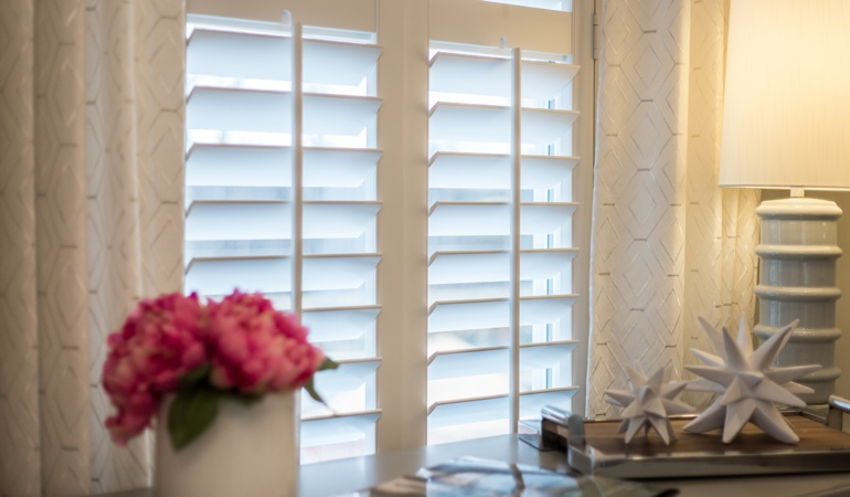 Plantation shutters by flowers in Minneapolis