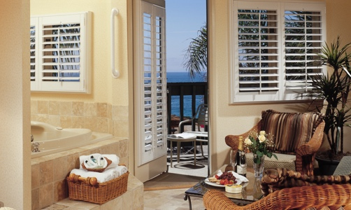 Plantation shutters on casement windows in a beachfront condo.