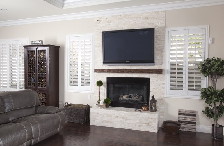 White plantation shutters in a Minneapolis living room with solid hardwood floors.