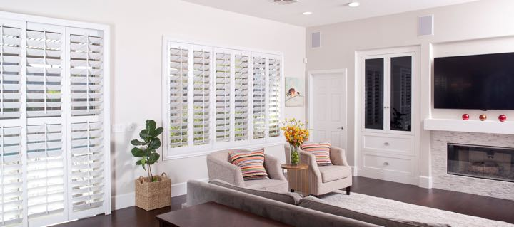 Minneapolis living room in white with plantation shutters.