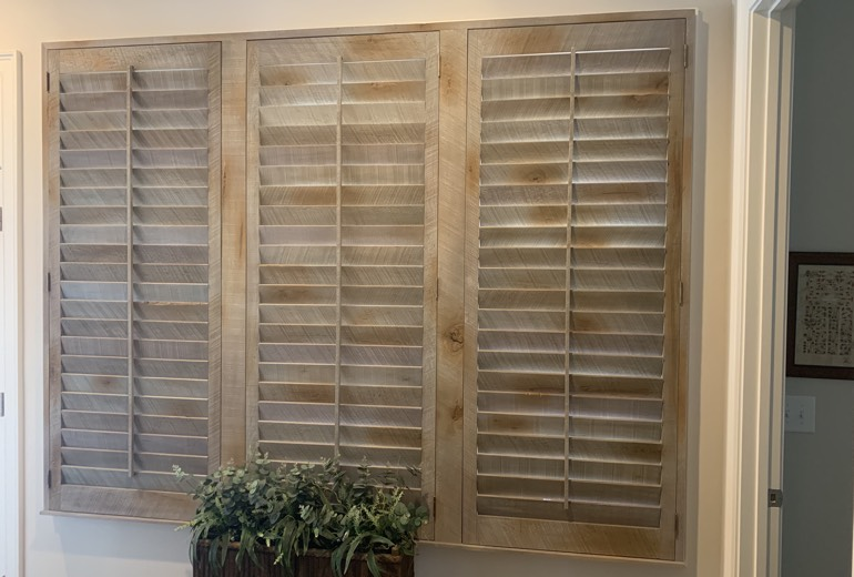 Closed reclaimed wood shutters in Minneapolis