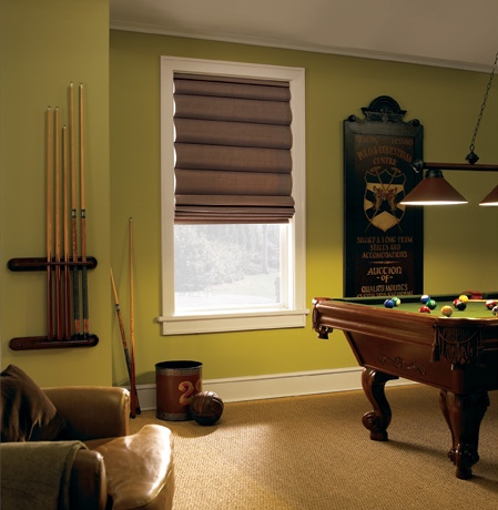 Roman shades in Minneapolis rec room with green walls.