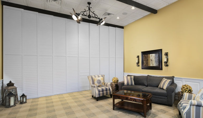 Interior shutters as a room divider for a showroom