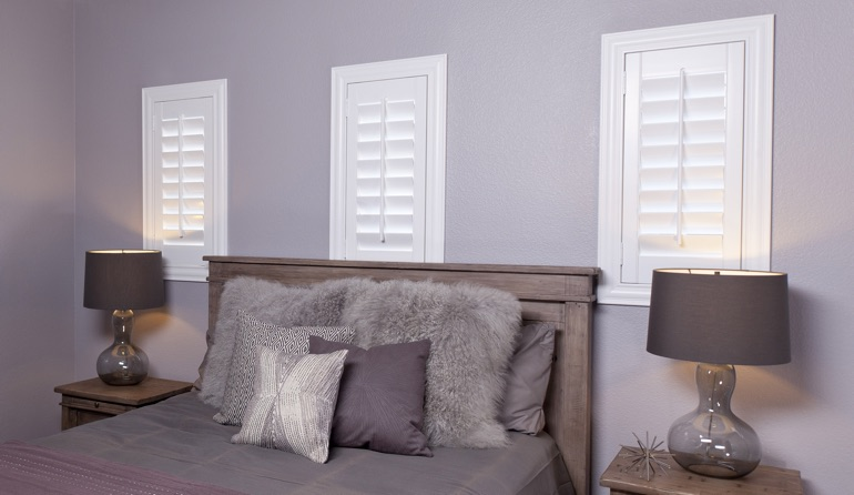 Classic plantation shutters in Minneapolis bedroom windows.