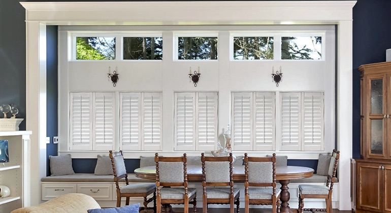 Shut white plantation shutters in Minneapolis dining room.