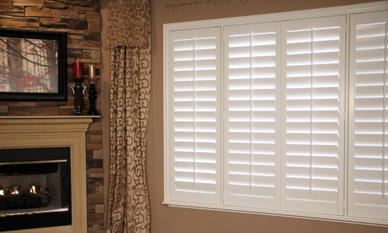 Minneapolis Studio plantation shutters in family room.