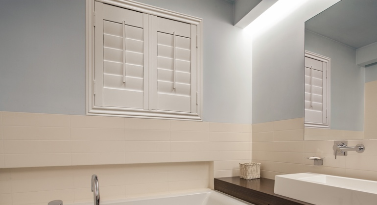 Studio waterproof shutters in Minneapolis bathroom.
