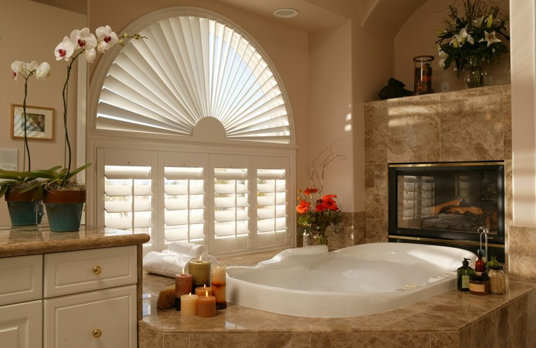 Arched shutters in a Minneapolis bathroom.