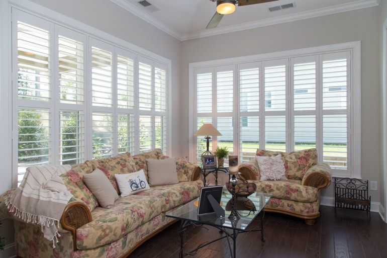 Traditional sunroom with interior shutters in Minneapolis.