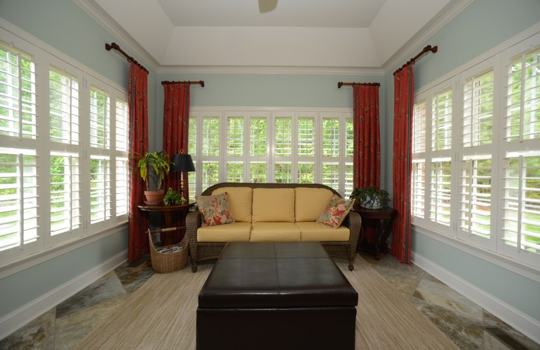 Minneapolis sunroom with plantation window shutters.