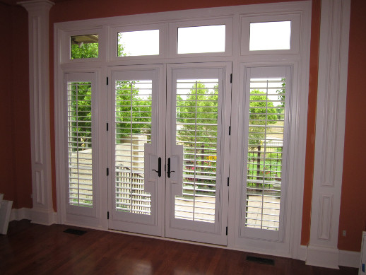 Minneapolis patio door with sidelight shutters