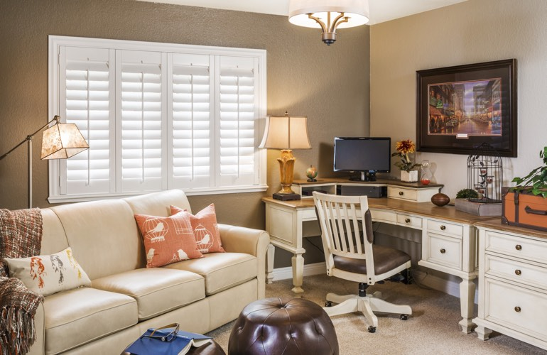 Minneapolis home office with plantation window shutters.