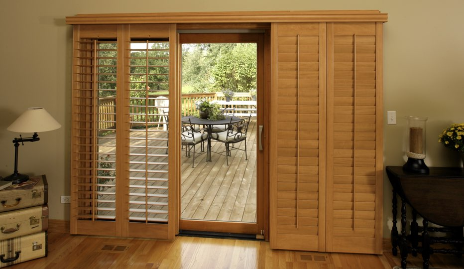 Bypass wood patio door shutters in Minneapolis living room